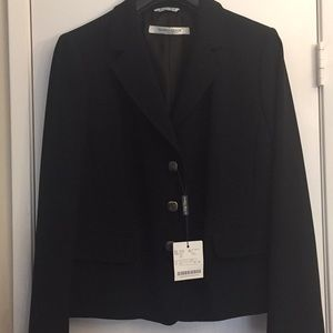 Marina Rinaldi short jacket with unique buttons.